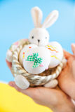Hands holding basket with Easter eggs Stock Photography