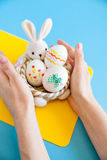 Hands holding basket with Easter eggs Stock Photo