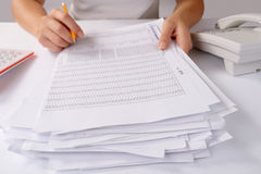 Hands holding a batch of loose paperwork Stock Photography