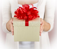 Hands holding beautiful gift box Stock Images