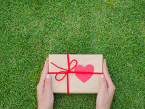Hands holding beautiful gift box Stock Photo