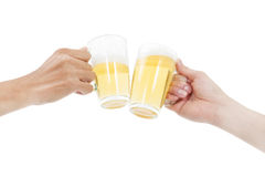 Hands holding beers making a toast Royalty Free Stock Photos
