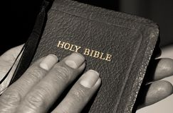 Hands Holding Bible Royalty Free Stock Image