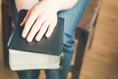 Hands Holding a Bible Royalty Free Stock Images