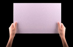 Hands holding big blank paper banner Royalty Free Stock Image