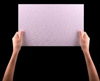 Hands holding big blank paper banner Stock Photography
