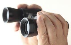 Hands holding binoculars Stock Photos