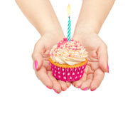 Hands holding a birthday cupcake Stock Photography
