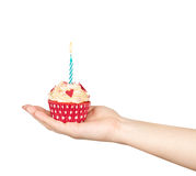 Hands holding a birthday cupcake Stock Photo
