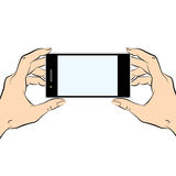 Hands holding a black smart phone. Human hands holding a black smart phone Stock Photo