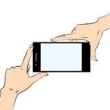 Hands holding black smart phone. Human hands holding a black smart phone Royalty Free Stock Photo