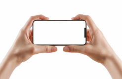 Hands holding black smart phone on white clipping path inside Royalty Free Stock Image