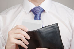 Hands holding black wallet full of money Royalty Free Stock Photography