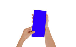 Hands holding blank blue brochure booklet in the hand. Leaflet p royalty free stock photography