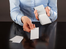 Hands holding blank business cards Stock Photo