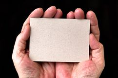 Hands holding a blank card Royalty Free Stock Image