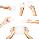Hands holding blank cards poster. Hands holding white blank templates set for business identification cards samples promotion advertisement banner abstract Royalty Free Stock Photography