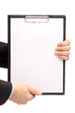 Hands holding a blank clipboard Stock Photography