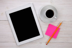 Hands holding blank digital tablet, notepad and cup of coffee on Stock Photos
