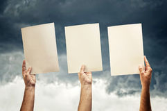 Hands holding blank papers Royalty Free Stock Photo