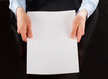 Hands holding blank sheet of paper Royalty Free Stock Images