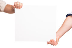 Hands holding a blank white board Royalty Free Stock Image