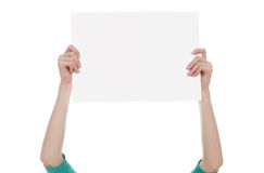 Hands holding a blank white paper Stock Photography