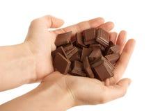 Hands holding blocks of Chocolate Stock Image