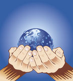 Hands holding blue earth Royalty Free Stock Images