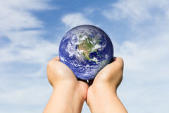 Hands holding blue earth on cloud and sky. Elements of this imag Royalty Free Stock Photography