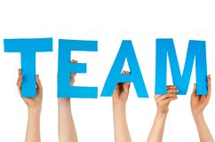 Hands holding blue letters building team Stock Photos