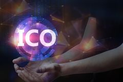 Initial coin offering concept. Hands holding blurry glowing ICO hologram on dark background. Initial coin offering concept. Double exposure Stock Photography