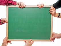 Hands holding board Royalty Free Stock Photography