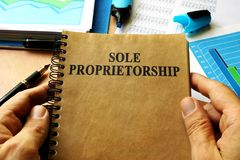 Hands holding book Sole proprietorship. Stock Photography