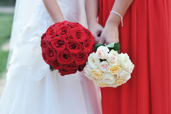 Hands holding bouquet Royalty Free Stock Photos