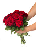 Hands holding bouquet of  roses Royalty Free Stock Photos