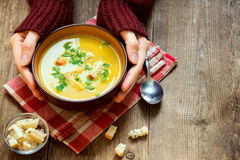 Hands holding bowl of soup Stock Images