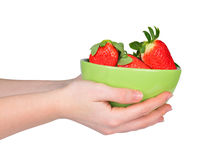 Hands holding a bowl of strawberries Stock Photos