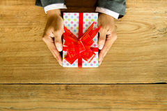 Hands holding a box with bows Stock Photos