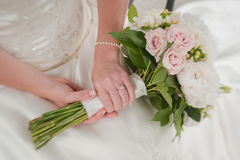 Hands Holding Bridal Bouquet Stock Photo