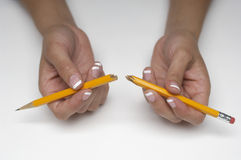 Hands Holding Broken Pencil Stock Photography
