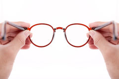 Hands holding brown glasses Stock Images