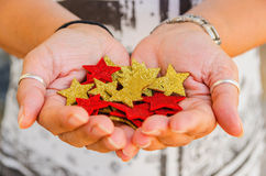Hands holding a bunch of stars Stock Images