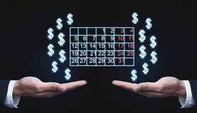 Hands holding calendar and dollar signs. royalty free stock images