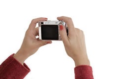 Hands holding camera Royalty Free Stock Images