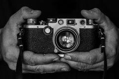 Hands Holding a Camera Stock Photography