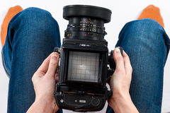 Hands holding camera Royalty Free Stock Photography