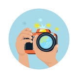 Hands holding camera and photographing Royalty Free Stock Images