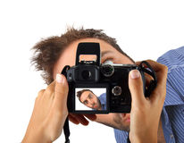 Hands holding a camera and taking a photo to wow man. Royalty Free Stock Images