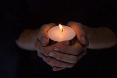 Hands holding candle Stock Image